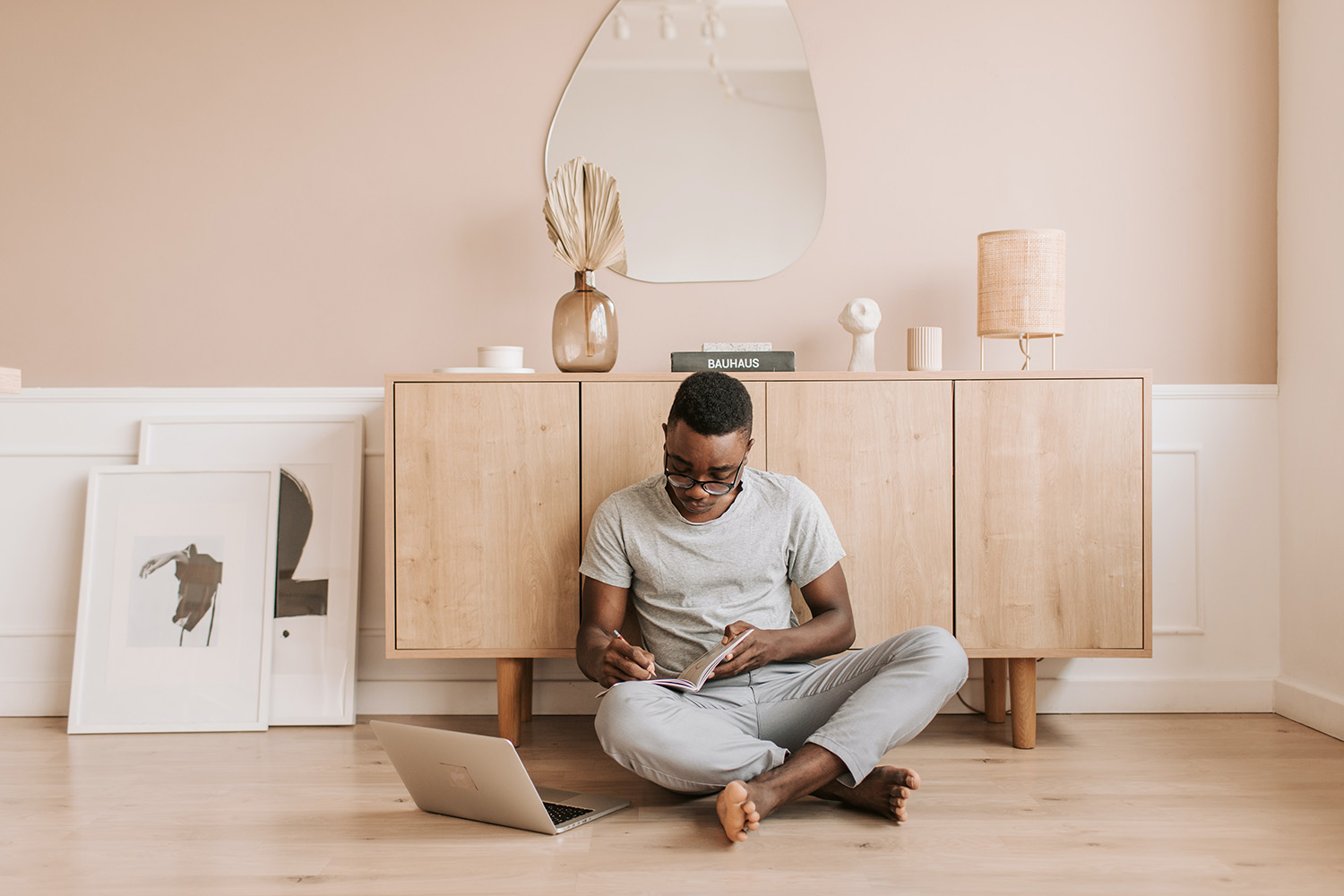 African History Project - Black Man with Computer on Floor copy