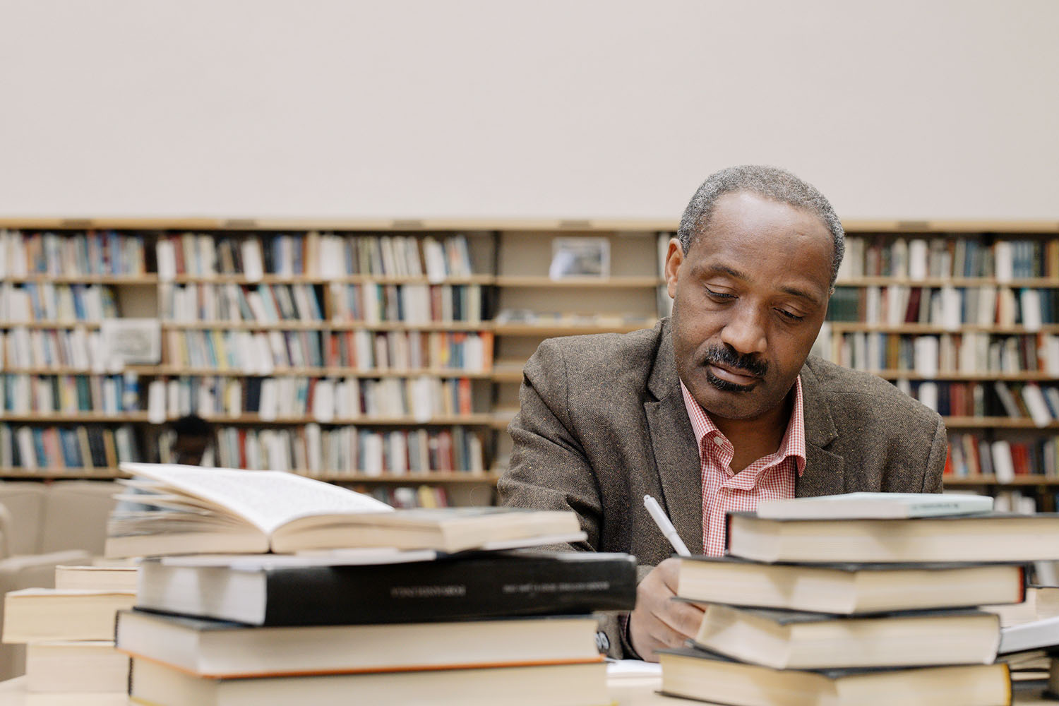African History Project - Black Man Reading Library copy