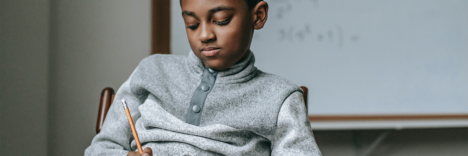 African History Project - Black Boy Studying Reading copy