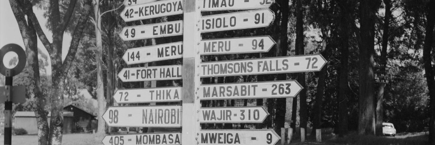 African History Project - Kenya, directional sign with city names and distance copy