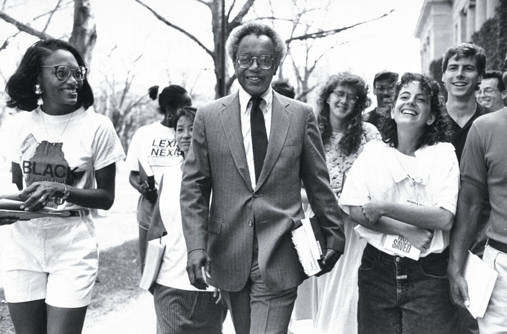 Harvard Law School professor Derrick Bell (C) walking w. a group of law students on campus after taking a voluntary unpaid leave of absence to protest the law school's practice of not granting tenure to minority women professors.  (Photo by Steve Liss//Time Life Pictures/Getty Images)